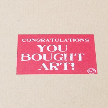 "An image of the ""Congratulations! You Bought Art"" Sticker placed on every John Dunne Photography Shipment"