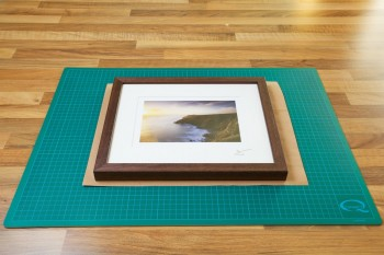 An image Framed Print being placed over the pre-cut Kraft Paper and stuck down from John Dunne Photography