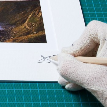 An image of me signing the Matte from one of my original Prints from John Dunne Photography